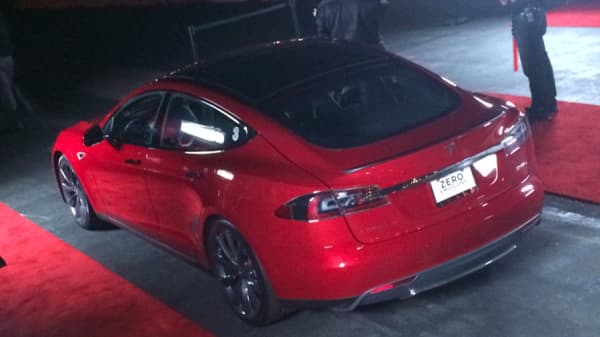 Tesla's new Model D car outside the company'e unveiling event
